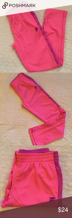 Girls Fila sweatpants Size 14/16 but compared to my girls jeans in my closet they look around the same waist size   Pink and purple   New condition   These pants were not made with a drawstring Fila Bottoms Sweatpants & Joggers