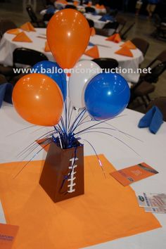 UF football themed centerpiece.   #UFBALLOONS #UF #FOOTBALLCENTERPIECE