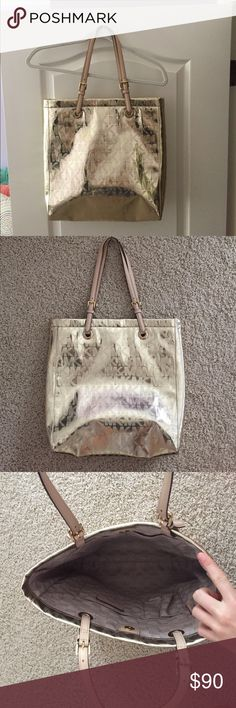Gold Michael Kors tote purse Michael Kors 'Jet Set' tote purse in excellent condition. Color is a light metallic gold. Michael Kors Bags Totes