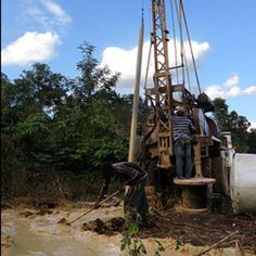 Well drilling rig operators hard at work in Haiti.