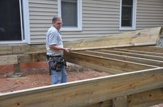Step by step instructions and tips on how to frame a deck. Learn how to install treated wood joists and beams to build a strong deck.