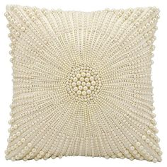 Add a pop of style to your favorite chaise or arm chair with this lovely pillow, featuring faux pearls embroidered into an eye-catching medallion.