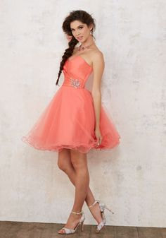 Quinceanera Dresses by Morilee designed by Madeline Gardner. Quinceañera Dress Featuring a Sweetheart Satin Bodice Accented with Beading and Short Tulle Skirt.