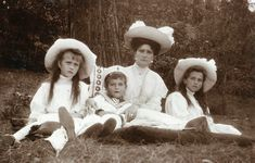 Empress Alexandra and her three youngest children, Grand Duchesses Maria and Anastasia, and Tzarevich Alexei