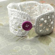 This bracelet is made from 5 tiny granny squares and a fun bright purple button