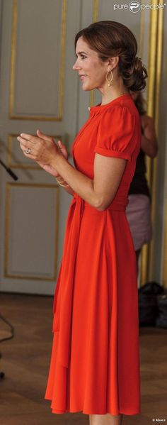 Crown Princess Mary of Denmark ... in that stunning orange dress, at the St Petersburg Loye Prize and Medals Ceremony.