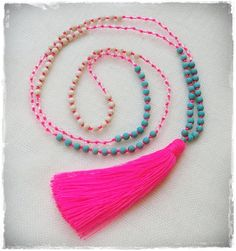 Neon pink tassel necklace with turquoise, cream and clear crystal glass beads on Etsy, $25.00