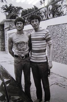 Bruce and a pal outside of Bruce's home, number 41 Cumberland road Kowloon