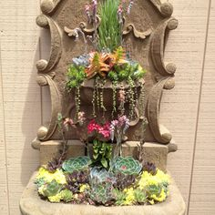 Succulents - great reuse of an old fountain!