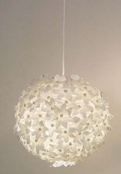 Fake flowers glued on a Chinese paper lantern-- great makeover!