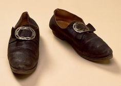 Men's shoes were made in a great variety of styles and qualities. Fashionable low-heeled shoes or pumps were of softer leather, coarse common shoes of sturdier leathers. Black was by far the most usual color, and only occasionally were other colors seen. While buckles were the primary mode of fastening, ties were worn for utilitarian purposes. Boots of many sorts were worn for sporting, riding and working.