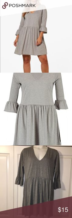 Boohoo plus Kathy v-neck skater dress in Grey! Never worn brand new! Bought it one size too big, to much of a hassle to return! Perfect condition, light grey skater dress with flare sleeves. Make an offer or bundle to save! Thanks for looking in my closet! All sales go towards my college fund! Happy poshing 💕!  (Some photos are stock photos) Boohoo Plus Dresses Long Sleeve