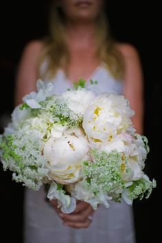 Beautiful all-white bouquet for Telluride, Colorado ranch wedding, photos by Chowen Photography | via junebugweddings.com