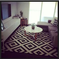 Ikea living room....Love that rug.