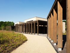 Waugh Thistleton has added a pair of new prayer halls to a Jewish cemetery in Hertfordshire, which features rammed-earth walls. Classical Architecture, Contemporary Architecture, Architecture Details, Organic Architecture, Residential Architecture, Healthcare Architecture, Johnson House, World Architecture Festival, Rammed Earth Wall
