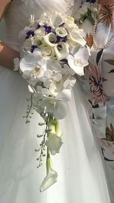 A close up of a gorgeous shower bouquet including calla lilies and orchids #parsleyandsage #flowers #weddingseason #orchids