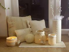 świeczniki i poduszki ze swetrów.