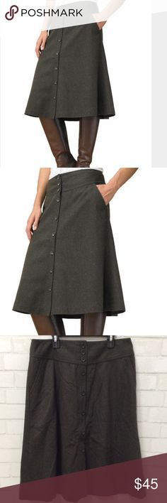 "Banana Republic Flannel Wool A-Line skirt Banana Republic Wool Blend A-Line skirt. Skirt has a three button waist and an A-Line button down front. Fully lined. measurements approximately: Waist 32"" Length 26"" Material: Shell 80% wool 20% Nylon . Lining 100% acetate Banana Republic Skirts Midi"