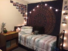 Love the colours in this cool uni bedroom! The photos on the wall are placed in a quirky shape and the fairy lights hanging across the window make it feel more cosy! Why not try hanging up your own photos and fairy lights using commandstrips.co.uk
