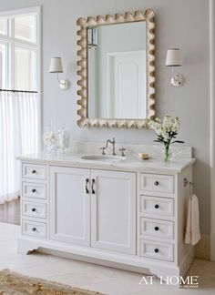 benjamin moore gray owl in a bathroom with white vanity and mirror. Color Trends 2016