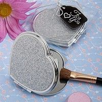 Heart shaped metal compact with silver glitter cover