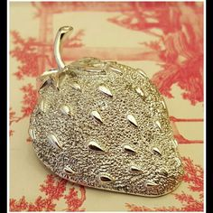 Vintage Big Strawberry Brooch Silver Big Strawberry Brooch Vintage Silver tone heavily detailed and textured. Perfect for your cardigan or scarf.   Sarah Coventry signed  Brooch is in great vintage condition -underside shows tarnish -topside does not  BEAUTIFUL!! Sarah Coventry Jewelry Brooches