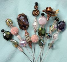 Hatpins made by Mitzi Curi at www.mitzismiscellany.com