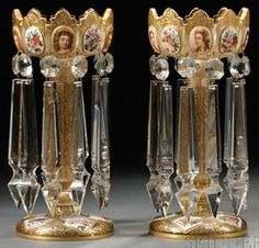 lighting, Czechoslovakia, Pair of Bohemian white cased glass mantel lustres, each with crenellated rim tapering to knopped stem, on circular foot, polychrome enameled and gilded with medallions featuring young beauties and flower sprays, on ground decorated with foliate arabesques. Circa 1891-1900