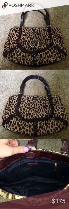 """DKNY Leopard purse Beautiful calf skin leopard print purse. Buckle clips in the front. 3 interior pockets - 2 slip and one zip. Approx 9""""h x 13""""w. DKNY Bags"""