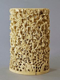 A large Chinese ivory carved cylindrical vase, late 19th/early 20th century, carved and pierced with flowering chrysanthemums and rock work, 21cm. high