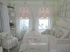 Notice the window above the bed.  I totally adore the curtains.  I shall learn how to make that style.