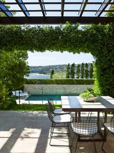 ocean front, ocean view, outdoor living, al fresco, dining, contemporary interior design, wire chairs, hedge