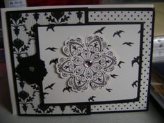 Elegant Stampin' Up tri-fold card.  Beautiful enough for a wedding, anniversary or birthday. The black flower holds the card closed.