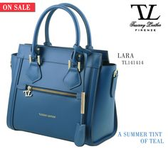 An excellent piece of Italian style. Ruga leather handbag LARA. http://www.tuscanyleather.it/en/p/leather-handbags/lara-ruga-leather-handbag-with-front-zip-teal  #tuscanyleather