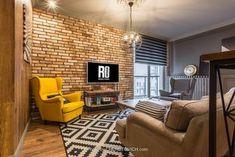 Salon w stylu industrialnym, z charakterystycznymi metalowymi elementami mebli i geometrycznymi wzorami na dywanie i...