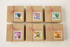 little boxes decorated with vintage stamps and twine