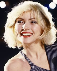 """Talk about pretty in punk! Blondie's """"Heart of Glass"""" single pushed the boundaries between the disco hits of the '70s, while offering a preview of the new wave trends of the '80s—and Debbie Harry's red lip followed suit. The saturated hue paid a nod to Harry's rocker-chic persona, while the glossy finish gave the look a modern edge."""