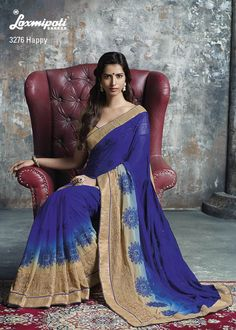 Blue color lover must be like this saree. The dark blue & tusser embellish design with gold brocade blouse seems to be simplicity with soberness.