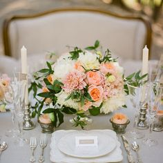 spring-wedding-centerpieces Blush and peach sweet peas, Juliet and Caramel Antique garden roses, white peonies and passion vines.