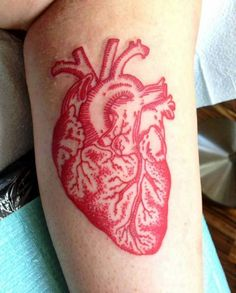 Great red ink tattoo by Laura Casey.