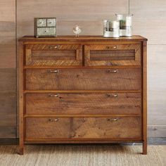 "PARK CITY HIGH DRESSER -- Enjoy contemporary design and rustic charm in our barnwood high dresser, as remarkable as it is useful. A horizontal/vertical ""patchwork"" of vintage pine barn siding incorporates five capacious drawers into its inspired design. Handcrafted in USA exclusively for Sundance. 48""W x 23-1/2""D x 44""H."