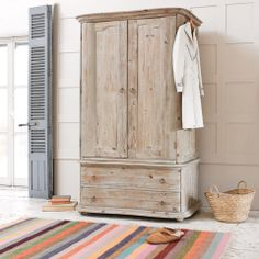 LOURDES. It's amazing what reclaimed wood and a little sand-blastage can do. We love the way this wonderfully weathered wardrobe is curved not cornered. Softly does it. #BounjourBlighty #wardrobe #wood