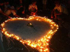 Painted heart in front of the makeshift memorial wins light #Justice #SM1ano