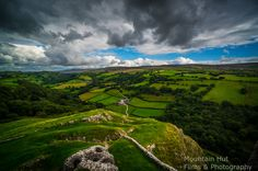 Wales, scenic vista with hills and greenery.