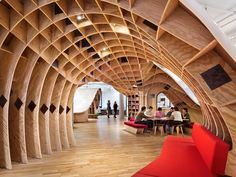 Clive Wilkinson Architects organized the Barbarian Group's New York office around a continuous communal desk. Photography by Michael Moran/Otto. New York Office, City Office, Office Desk, Architecture Design, Amazing Architecture, Timber Architecture, Barbarian Group, Karton Design, Espace Design