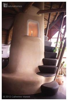 A cob bench isn't the only thing a rocket stove can warm up for you. This is a rocket stove powered staircase, sculpted out of cob by Danish architect, mason and thatcher Flemming Abrahamsson [www.fornyetenergi.dk]. It's included in the book 'Rocket Mass Heaters' available here www.rocketstoves.com by Ianto [www.cobcottage.com] and Leslie [www.well.com/~les/].