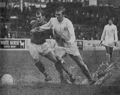 21st February 1970. At Portman Road, Mick Jones tussles against Ipswich Town's Mick McNeil on a deteriorating waterlogged pitch that eventually became too dangerous and the referee postponed the game.