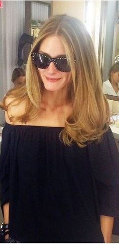 Olivia Palermo in Blaque Label black off the shoulder top and Italia Independent studded sunglasses
