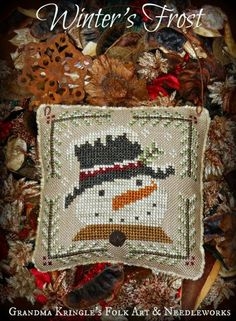 Winter's Frost is the title of this cross stitch pattern from Grandma Kringle's Needleworks featuring the most delightful snowman.