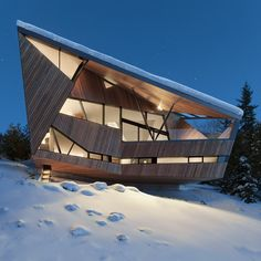 This snow country house is located on a northwest slope overlooking a panoramic view of Whistler valley in southwest British Columbia. The site is a difficult wedge shape which offers just enough room for a garage and narrow entrance on the street sid